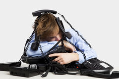 Wrapped in telephones Stock Photo