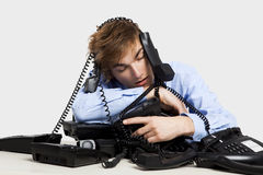 Wrapped in telephones Royalty Free Stock Photo