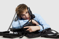 Wrapped in telephones Royalty Free Stock Photos