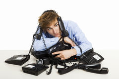 Wrapped in telephones Stock Photos