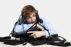 Wrapped in telephones Royalty Free Stock Images