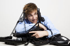 Wrapped in telephones Stock Images