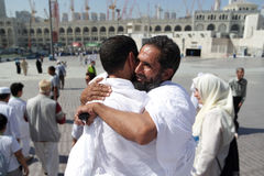Wrapped together two Muslim pilgrims Royalty Free Stock Photo