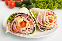 Wrapped tortilla sandwich rolls cut in half Stock Image