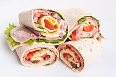 Wrapped tortilla sandwich rolls cut in half Stock Images