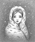 Wrapped up warm. Portrait of a girl wrapped up in a warm shawl Royalty Free Stock Image