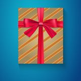 Wrapped vintage gift box with red ribbon bow, Stock Image
