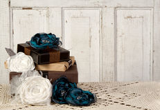Wrapped vintage packages with flowers. Wrapped vintage packages with vintage flowers against a vintage door Stock Photo