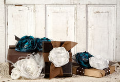 Wrapped vintage packages with flowers. Wrapped vintage packages with vintage flowers against a vintage door Stock Images