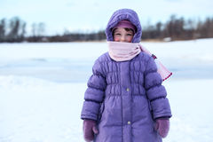 Wrapped in warm clothes small child standing outdoor Stock Photos
