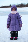 Wrapped in warm clothing little child standing outdoor Royalty Free Stock Photos