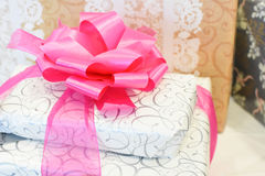 Wrapped Wedding Gifts. A wrapped wedding gift with large pink bow Stock Image