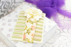Wrapped Wedding Gifts. A wrapped wedding gift with large purple bow and flowers and seashells royalty free stock image