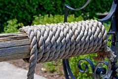 Wrapped well rope. Thick rope at a well wrapped around a wood shaft Royalty Free Stock Photo