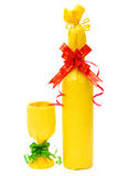 Wrapped wine and cup as gifts Royalty Free Stock Images