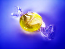 Wrapped yellow candy Stock Images