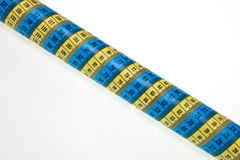 Wrapping. Measurement tapes wrapped around metal pipe Stock Photography