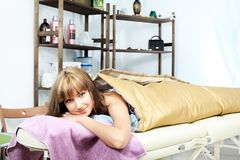 Wrapping. Beautiful young woman getting spa treatment at a salon. Beauty, healthcare Stock Images