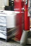 Wrapping. Blurry industrial wrapping machine on the work Stock Photography