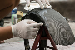 Wrapping carbon fiber or kevlar. And man hand for working Royalty Free Stock Images