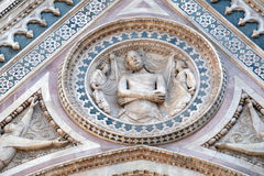Wrapping Christ in his shroud, Portal on the side-wall of Florence Cathedral Stock Images