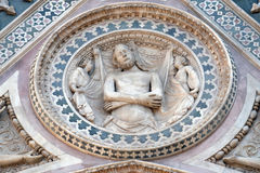 Wrapping Christ in his shroud, Portal on the side-wall of Florence Cathedral Royalty Free Stock Image