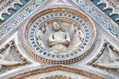 Wrapping Christ in his shroud, Portal on the side-wall of Florence Cathedral Royalty Free Stock Photography