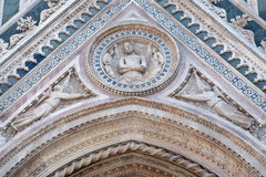 Wrapping Christ in his shroud, Portal on the side-wall of Florence Cathedral Royalty Free Stock Photos