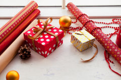 Wrapping Christmas gift - preparation. Accessories on wooden whi Royalty Free Stock Photos