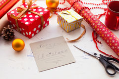 Wrapping Christmas gift - preparation. Accessories on wooden whi Stock Photo