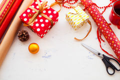 Wrapping Christmas gift - preparation. Accessories on wooden whi Royalty Free Stock Image