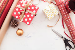 Wrapping Christmas gift - preparation. Accessories on wooden whi Stock Image