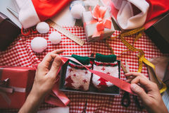 Wrapping Christmas gifts. Royalty Free Stock Photo