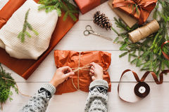 Wrapping christmas present gift on white wood background Royalty Free Stock Photography