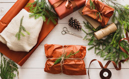 Wrapping christmas present gift on white wood background stock photos