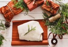 Wrapping christmas present gift on white wood background Royalty Free Stock Photo