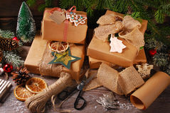 Wrapping christmas presents  in eco paper Royalty Free Stock Image