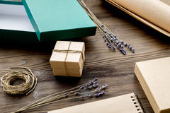 Wrapping gifts in box for holiday on wooden background Stock Image