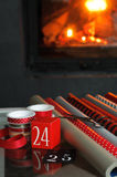 Wrapping gifts in front of fireplace Royalty Free Stock Photos