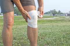 Wrapping knee injury Stock Photos