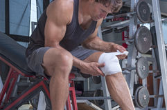 Wrapping knee injury Stock Photo