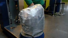 Wrapping luggage baggage bag at airport terminal Royalty Free Stock Photos