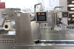 Wrapping machine. In a factory royalty free stock images