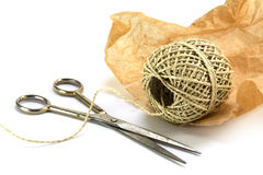 Wrapping material, ball of string, paper and scissors isolated w Royalty Free Stock Photo