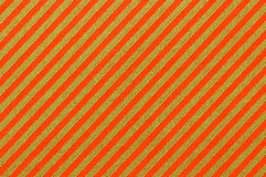 Wrapping paper. A macro shot of cheery striped wrapping paper royalty free stock images