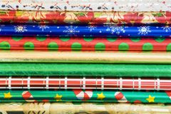 Wrapping paper background. Rolls of colorful wrapping paper for Christmas/New Year gifts Stock Image