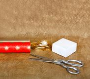 Wrapping paper and boxes for gifts with ribbons and scissors Royalty Free Stock Images