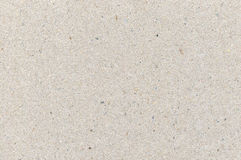 Wrapping paper cardboard texture, light rough textured copy space background, grey, gray, brown, tan, yellow, beige, horizontal Stock Images