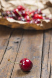 A wrapping paper with cherries on the table Stock Photography