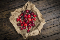A wrapping paper with cherries on the table Stock Photo
